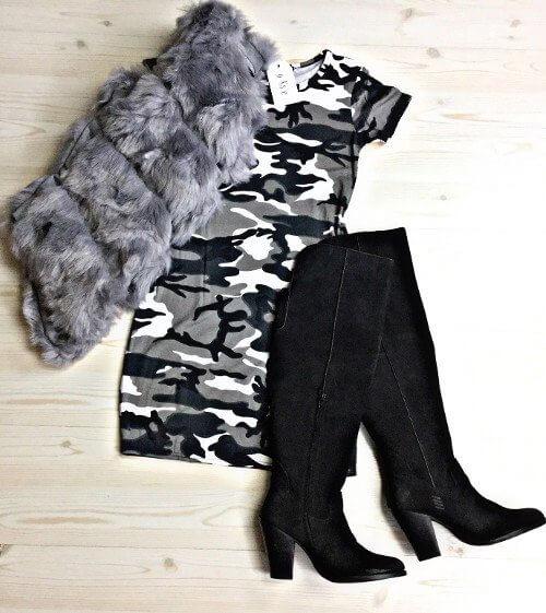 Add a faux fur vest to a statement dress.