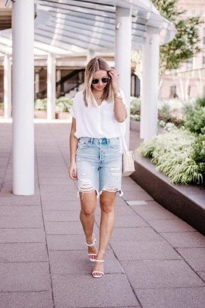 Distressed denim Bermuda's paired with a simple tee