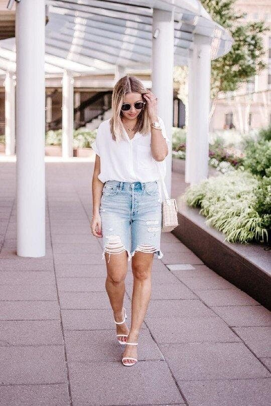 Distressed denim Bermuda's paired with a simple tee & sandals for a cute daytime look.