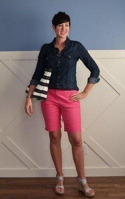 For a sophisticated look, pink Bermuda's paired with a denim jacket & sandals.