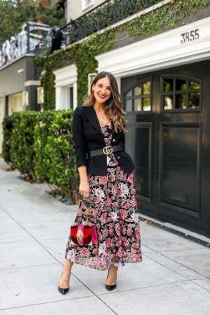 A lovely feminine look with a black blazer over a floral midi dress